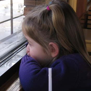 sad girl at window
