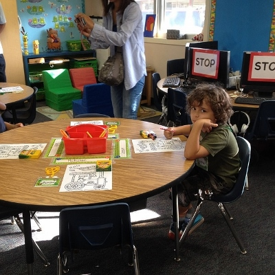 child in classroom (400x400)