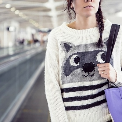 woman in airport (400x400)