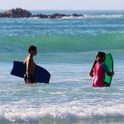 tweens swimming in ocean (400x400)