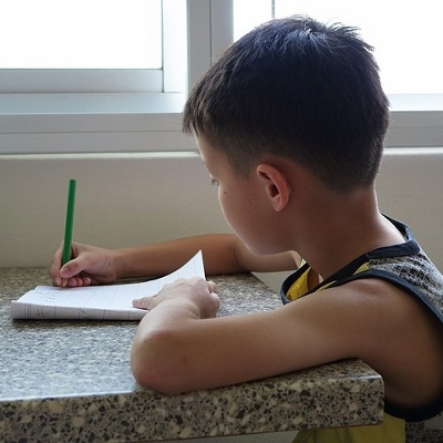 child doing homework (400x400)