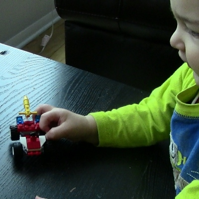 toddler with toy (400x400)