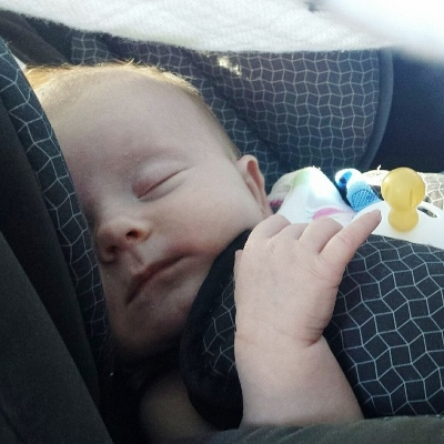 baby in car seat (400x400)