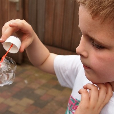 boy playing with bubbles (400x399)