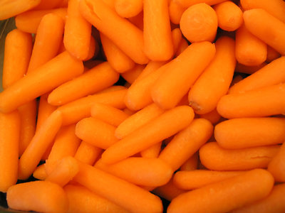Baby peeled carrots in a bowl for a picnic