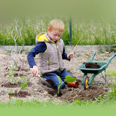 Elementary-age-in-a-garden