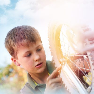 7-8-year-old-checking-tires-on-a-child-bike