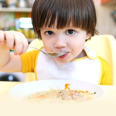 2-year-old-feeding-himself-with-a-spoon