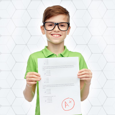 8-year-old-smiling-with-a-paper-from-school